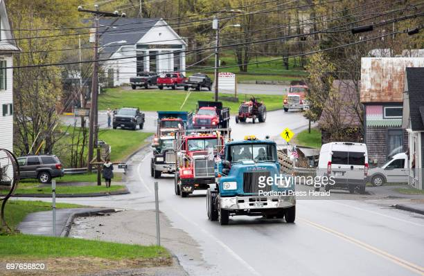 A brigade of trucks passes through Canaan before the funeral for Butch Clark a milk hauler who died in January when his Mack truck left the roadway...