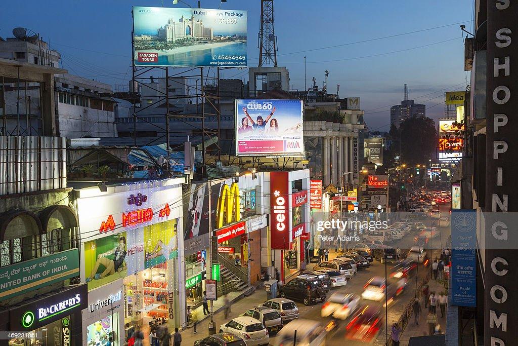 Brigade Road Shops & Cars at Dusk, Bangalore
