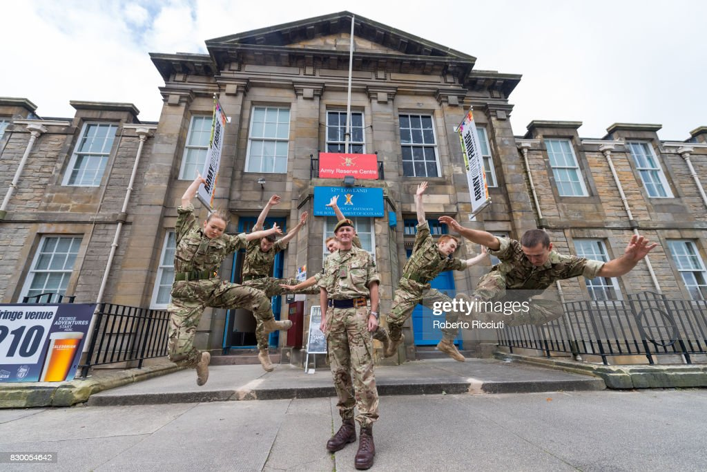 Brigadier Gary Deakin CBE, head of the Army in Scotland, poses with dancers from '5 SOLDIERS' for the opening of Army@TheFringe at Hepburn House Army Reserve Centre during the annual Edinburgh Fringe Festival on August 11, 2017 in Edinburgh, Scotland. The Hepburn House Army Reserve is the Army's first ever Fringe Venue.