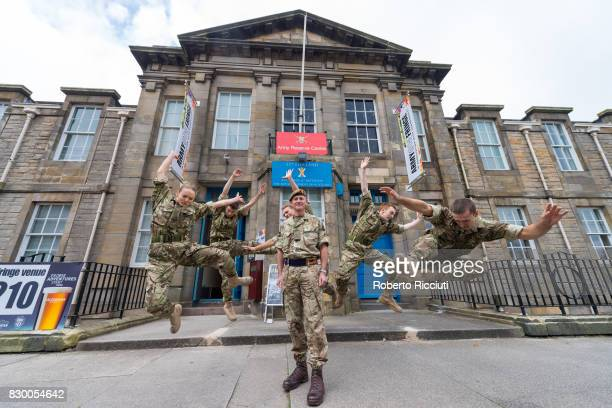 Brigadier Gary Deakin CBE head of the Army in Scotland poses with dancers from '5 SOLDIERS' for the opening of Army@TheFringe at Hepburn House Army...