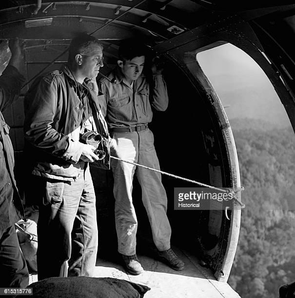 Brigadier General Frank Merrill Commander of famous Merrill Marauders is standing in the open door of a Douglas DC3 flying over north Burma to drop...