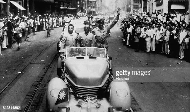 Brigadier General Frederick W Boye central commander of the United States Army Chinese combat command waves during a parade down Nanking Road in...