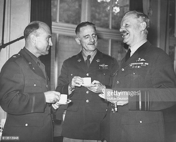 Brigadier general Ira Clarence Eaker chats over tea with Sir Arthur Harris and general Carl Spaatz at a US Army Air Corps station in Britain