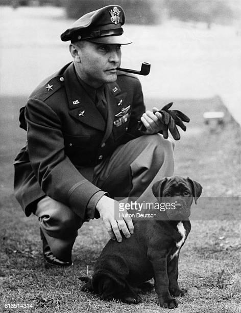 Brigadier general Ira Clarence Eaker commander of the US Bomber Command in Europe during World War II befriends mascot Winston Churchill during a...