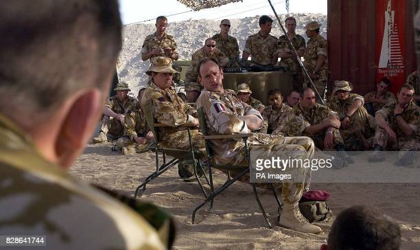 Brigadier Jacko Page briefs members of The Household Cavalry at their camp close to the Iraqi border