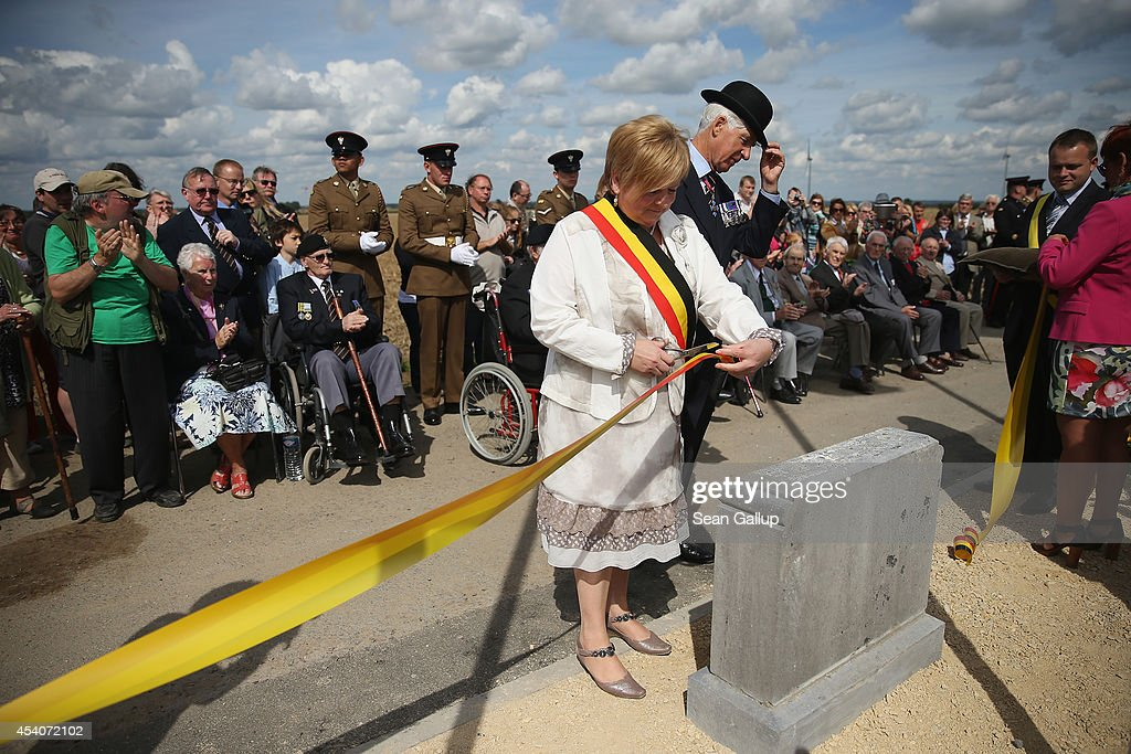 Brigadier Keith Prosser of the former Cheshire Regiment adjusts his hat as he and the village mayor cut the tape at the inauguration ceremony of a monument to honour members of the British Cheshire Regiment and other soldiers who died fighting the German Army exactly 100 years before at the same site during World War I on August 24, 2014 in Audregnies, Belgium. Of the 25 officers and 925 men of the 1st Battalion, Cheshire Regiment who fought that day on August 24, 1914, only a total of 207 would survive after two messengers with instructions for the unit to retreat failed to make it through. The battle came on the heals of the Battle of Mons the day before, which was the first major engagmement between British and German forces in the war. The British, French and Belgian armies were forced to continue their retreat until weeks later, when only a short distance from Paris they managed to reverse the tide of the war and push the Germans back north.