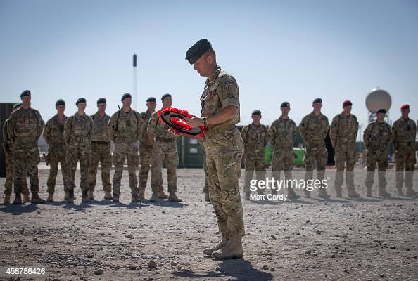 Brigadier Rob Thomson lays a wreath during a ceremony to mark Armistice Day attended by some of the British troops that still remain in Afghanistan...