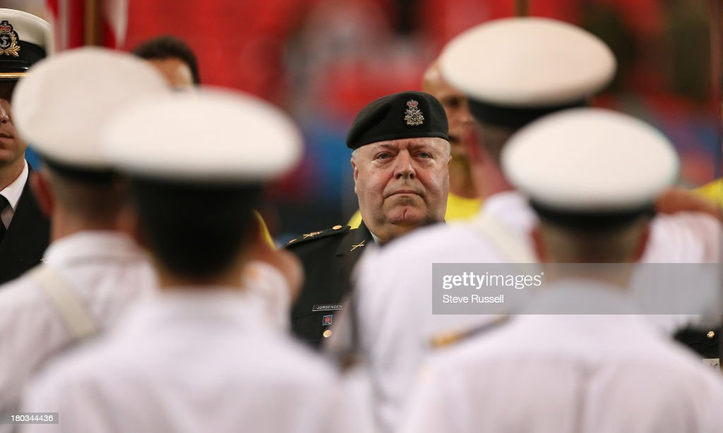 TORONTO, ON- SEPTEMBER 11 - Brigadier-General Joe Jorgensen listens to the anthems as Toronto FC remember the 9-11 attacks as Toronto FC and Chicago Fire tie 1-1 at BMO Field in Toronto, September 11, 2013.