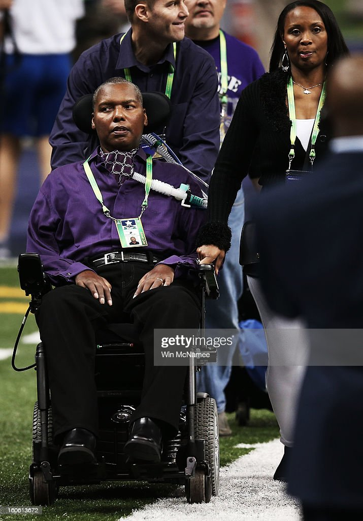 O.J. Brigance, Senior Advisor to Player Development for the Baltimore Ravens, is seen on the field with his wife Chanda prior to the Ravens playing against the San Francisco 49ers during Super Bowl XLVII at the Mercedes-Benz Superdome on February 3, 2013 in New Orleans, Louisiana.