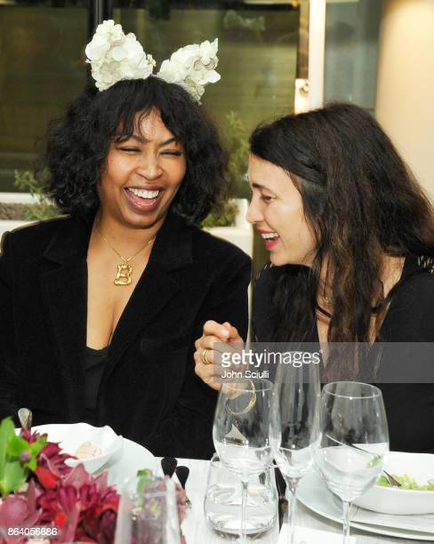 Brigette Romanek and Shiva Rose attend THE OUTNET x Amber Valletta at Waldorf Astoria Beverly Hills on October 19 2017 in Beverly Hills California