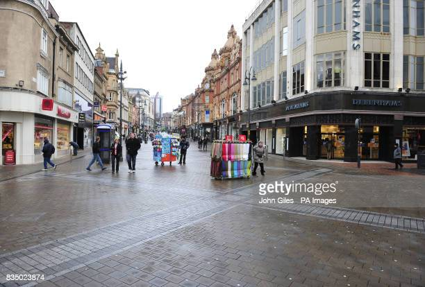Briggate one of the main shopping streets in Leeds City Centre which is almost deserted mid morning on a Friday as figures reveal the UK is...