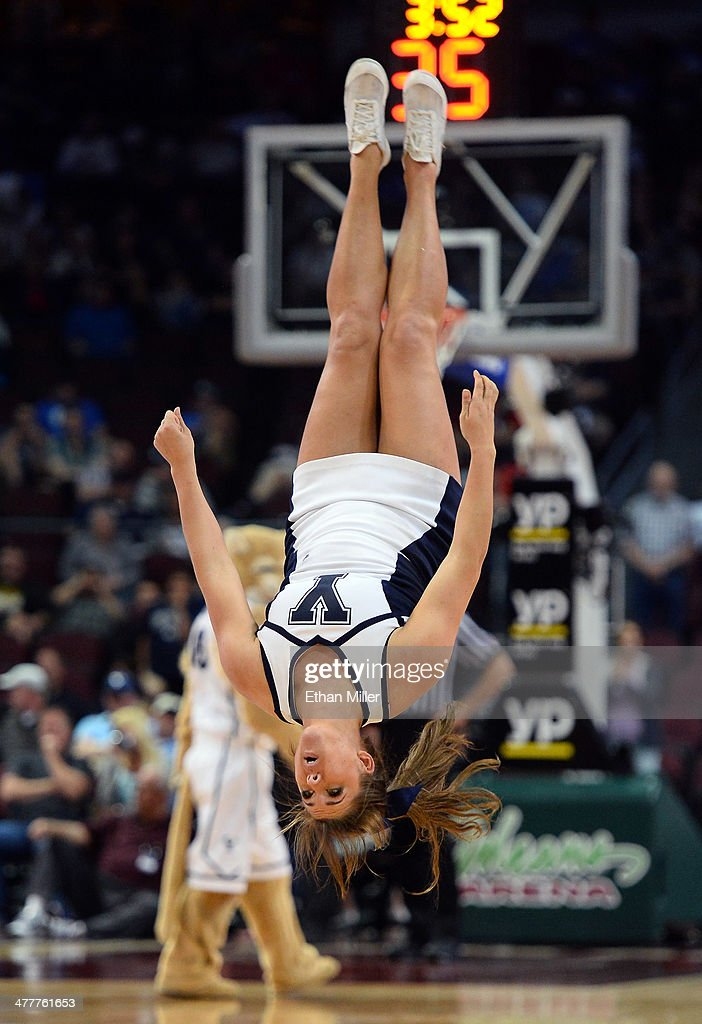 A Brigham Young Cougars cheerleader flips in the air as she performs during a semifinal game of the West Coast Conference Basketball tournament against the San Francisco Dons at the Orleans Arena on March 10, 2014 in Las Vegas, Nevada. Brigham Young won 79-77 in overtime.