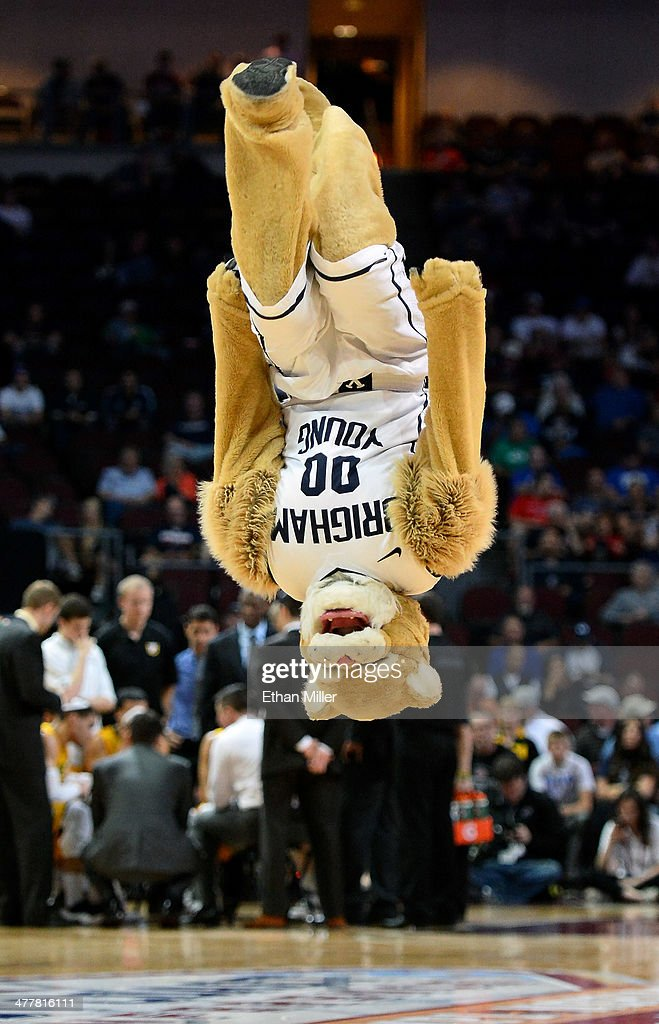 Brigham Young Cougars mascot Cosmo the Cougar flips in the air during a semifinal game of the West Coast Conference Basketball tournament against the San Francisco Dons at the Orleans Arena on March 10, 2014 in Las Vegas, Nevada. Brigham Young won 79-77 in overtime.