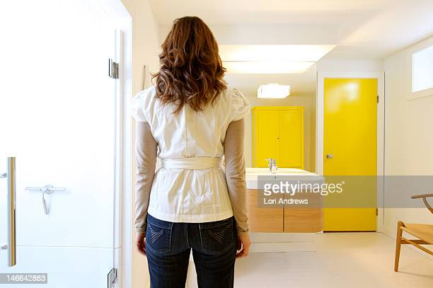 Bright bathroom with woman