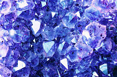 Bright Blue Texture from Natural Gemstone. Blue Crystal background for your jewelry designs.