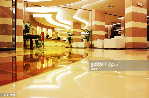 Bright, colorful hotel entrance in marble and stone