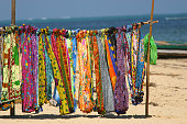 Row of sarongs for sale at the beach at Ifaty, Madagascar