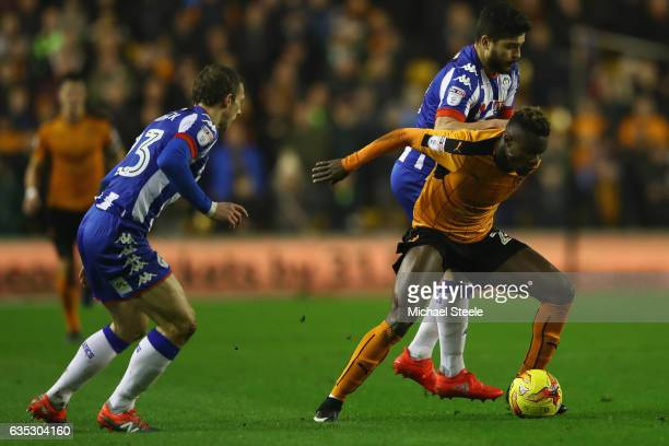 Bright Enobakhare of Wolverhampton is challenged by Sam Morsy of Wigan during the Sky Bet Championship match between Wolverhampton Wanderers and...