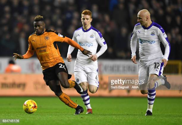 Bright Enobakhare of Wolverhampton Wanderers and Jonjo Shelvey of Newcastle United during the Sky Bet Championship match between Wolverhampton...