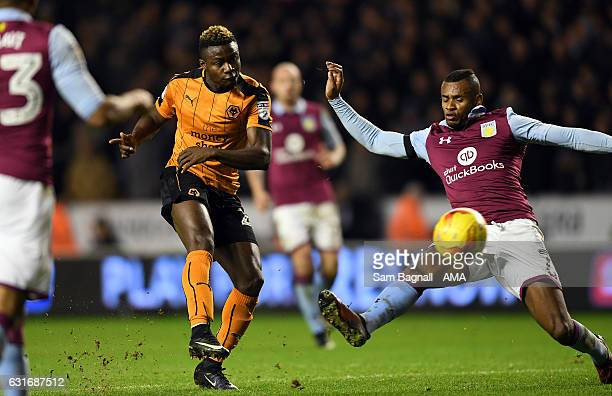 Bright Enobakhare of Wolverhampton Wanderers and Leandro Bacuna of Aston Villa during the Sky Bet Championship match between Wolverhampton Wanderers...