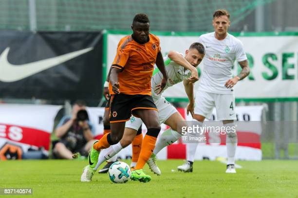 Bright Enobakhare of Wolverhampton Wanderers and Maximilian Eggestein of Bremen battle for the ball during the preseason friendly between Werder...