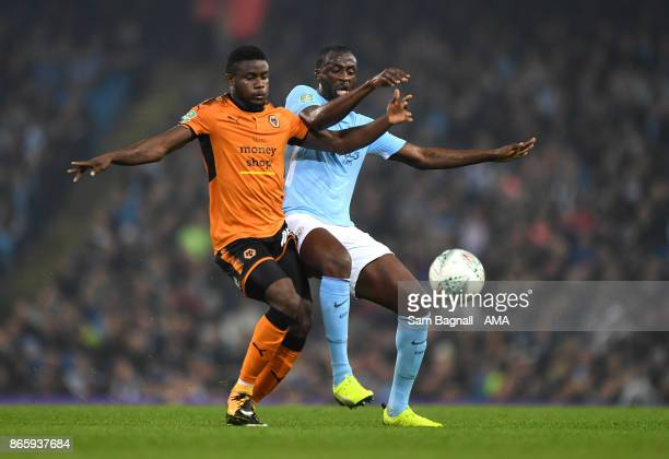 Bright Enobakhare of Wolverhampton Wanderers and Yaya Toure of Manchester City during the Carabao Cup Fourth Round match between Manchester City and...