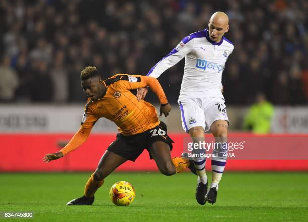 Bright Enobakhare of Wolverhampton Wanderers is fouled by Jonjo Shelvey of Newcastle United during the Sky Bet Championship match between...