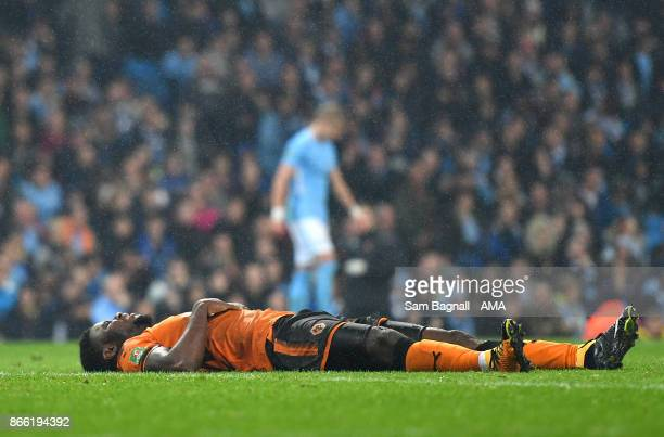 Bright Enobakhare of Wolverhampton Wanderers lies dejected after a missed chance during the Carabao Cup Fourth Round match between Manchester City...