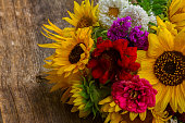 Bright bunch of fresh fall flowers on wooden table