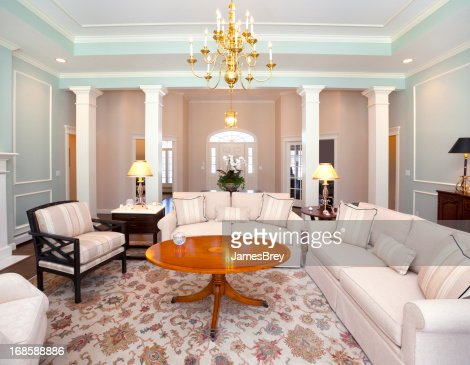 Bright Formal Living Room With Chandelier Stock Photo Getty Images