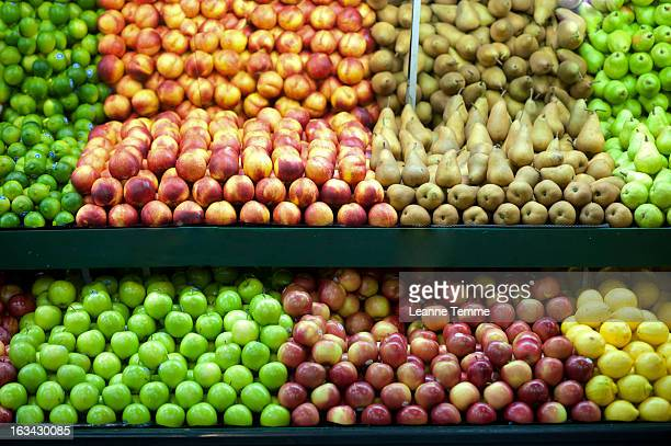 Bright fruits on stand at fruit and vegetable shop