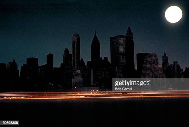 Bright full moon over darkened New York City skyline during massive East Coast blackout affecting 80000 square miles