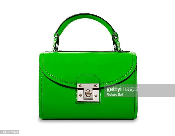 A bright green handbag on a white background.