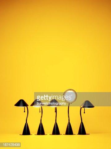 Bright Idea, Five desk lamps against yellow
