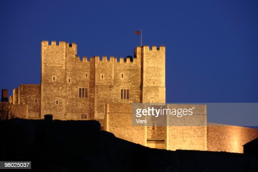 Bright lit Dover Castle in England at night