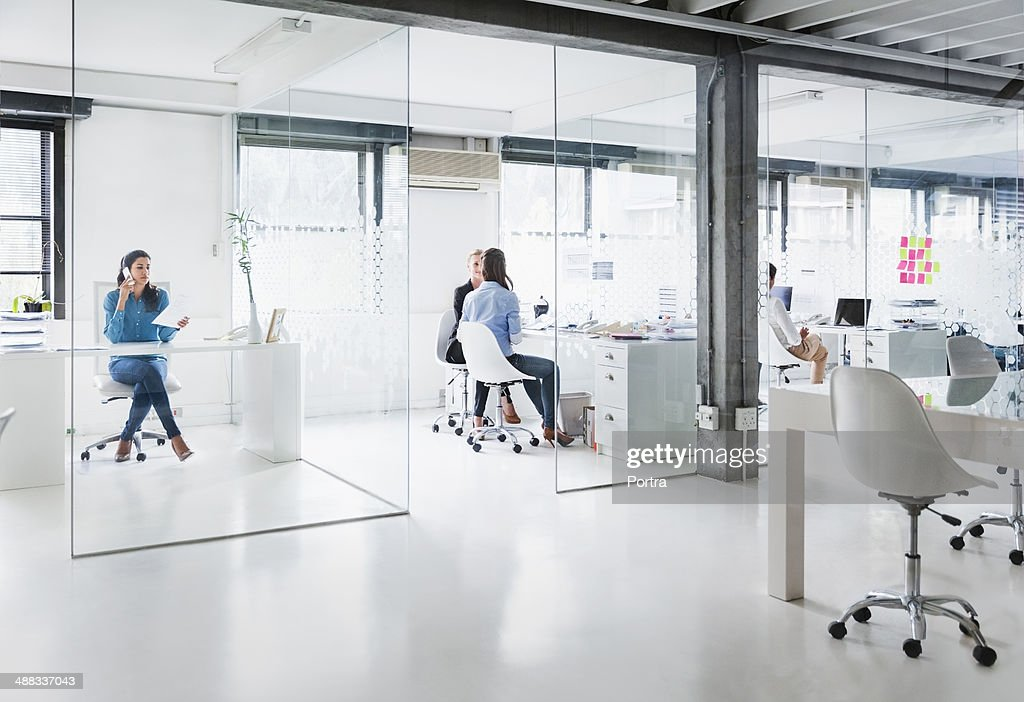 Bright modern office space with four women