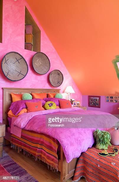 Bright pink and orange bedroom