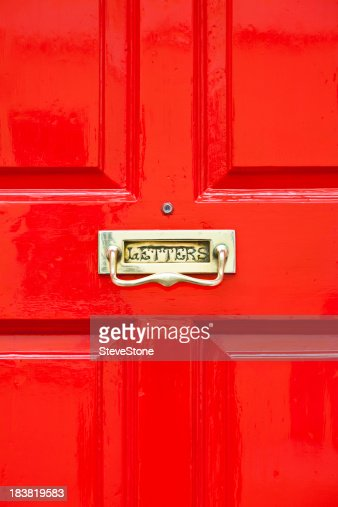 Bright Red Painted Door With Brass Letterbox Stock Photo | Getty Images