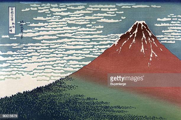 Bright Red snow capped Mount Fuji with clouds and snow