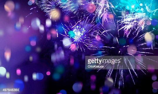 bright sparkling multicolor fireworks and confetti : Stock Photo