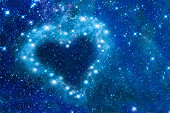 Bright stars in a night sky arranged in the shape of a heart, romantic magic night, love  and Valentines day card