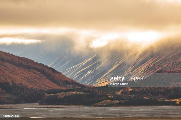 Bright sunlight through the clouds lighting up mountains