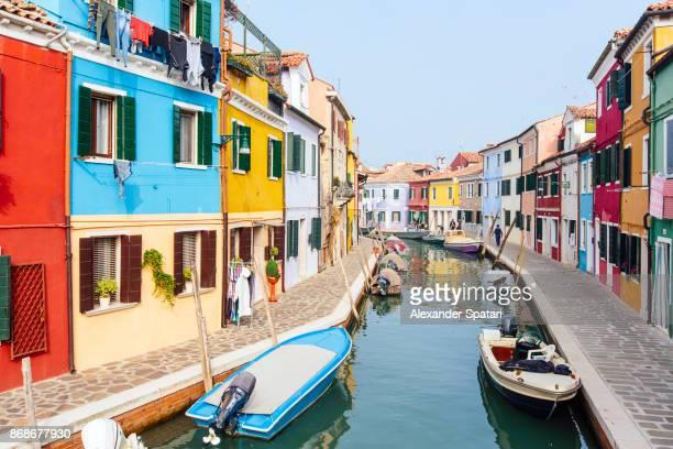 Bright vibrant houses along the canal in Burano, Veneto region, Italy