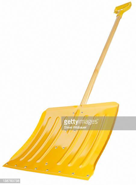 A bright yellow snow shovel