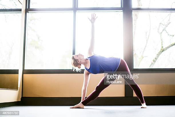 Bright Yoga Studio and Woman Practicing