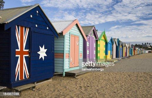 Brightly colored Brighton beach huts and sand