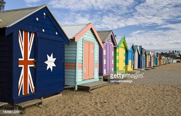 Brightly colored Brighton beach huts and sand