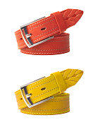 Brightly colored leather belts isolated on white background