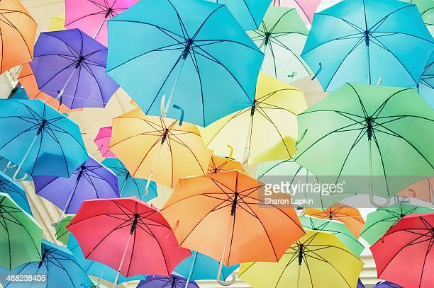 Brightly coloured umbrellas in the sky