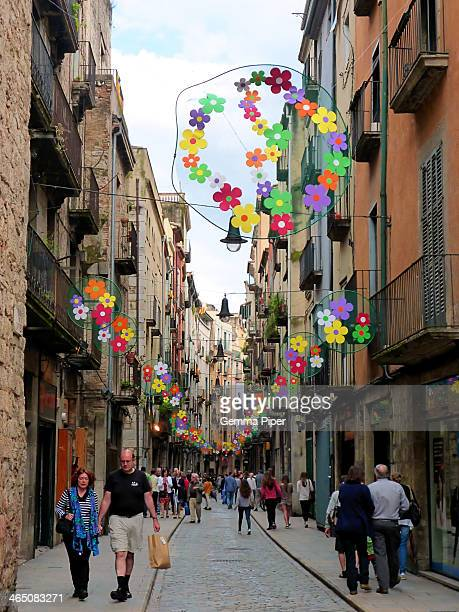 CONTENT] Brightly decorated small shopping streets of Girona being used by locals and tourists